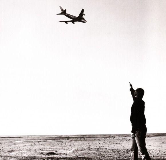 Caption: Chris Burden shooting an airplane.
